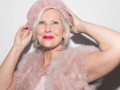 Portrait confident, glamorous senior woman wearing pink fur